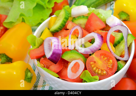 Fresh vegetable salad in white bowl on a table - Stock Photo