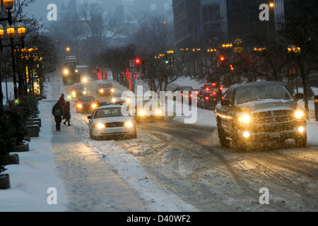 Downtown Montreal, Quebec during a heavy snowfall. - Stock Photo