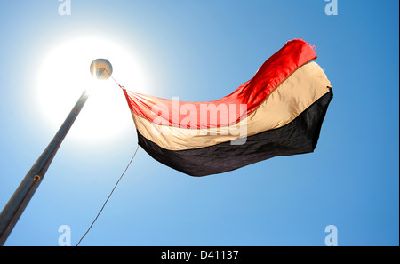 The National flag of Yemen flying over the capital city of Sana'a. - Stock Photo