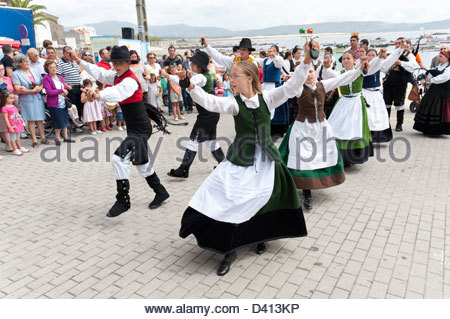 Children performing traditional folk dance during annual fiestas, Corrubedo, Rias Baixas, Galicia, Spain - Stock Photo