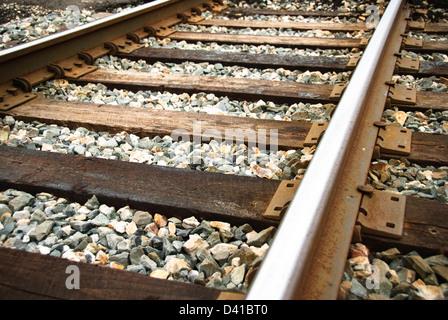 Railway tracks up-close on a sunny day. - Stock Photo