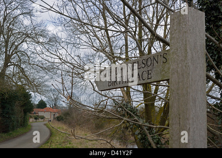 Sign pointing towards birthplace of Admiral Lord Nelson in Burnham Thorpe, Norfolk - Stock Photo