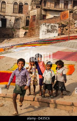 children on the ghats of Varanasi, India - Stock Photo