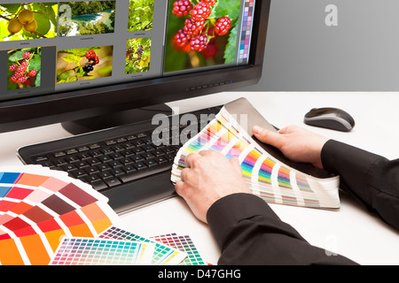 Graphic designer at work. Color samples. Photo picture fruit and nature - Stock Photo