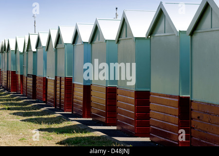 Rear view of beach huts at Hove, Sussex - Stock Photo
