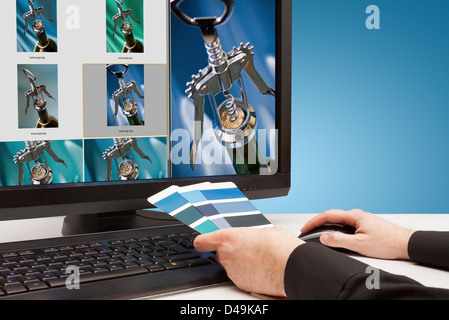 Graphic designer at work. Color samples blue. Select photos picture - Stock Photo