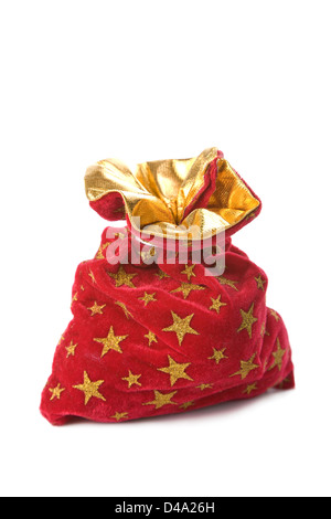 red christmas sack full of gifts isolated - Stock Photo