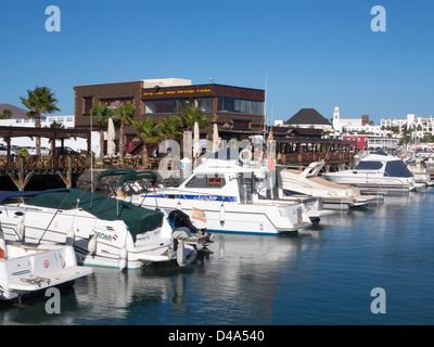 Lani's restaurant and moored boats at Marina Rubicon, Playa Blanca, Lanzarote - Stock Photo