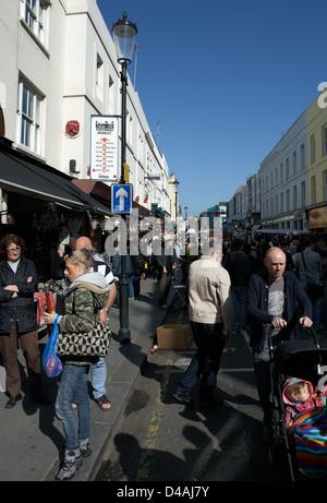 London, United Kingdom, visitors to the famous Portobello Road Market - Stock Photo