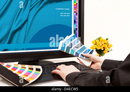 Graphic designer at work. Color samples. - Stock Photo