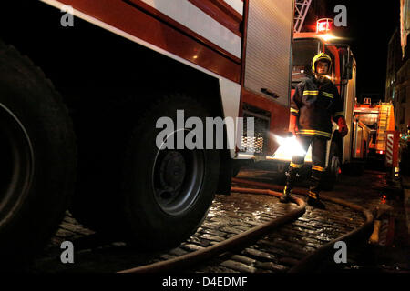 Thessaloniki, Greece. 12th March 2013. Arson attack with gas canisters in the offices of New Democracy MPs. A building - Stock Photo