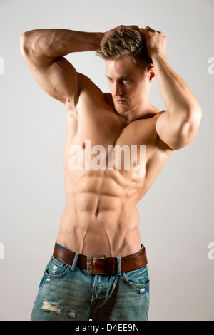 Well trained athlete with hands over his head - Stock Photo