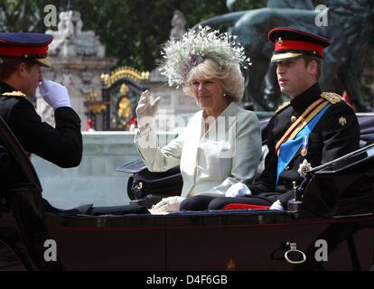 Prince William (R), Prince Harry and Camilla, Duchess of Cornwall are pictured at the 2008 Trooping the Colour parade - Stock Photo
