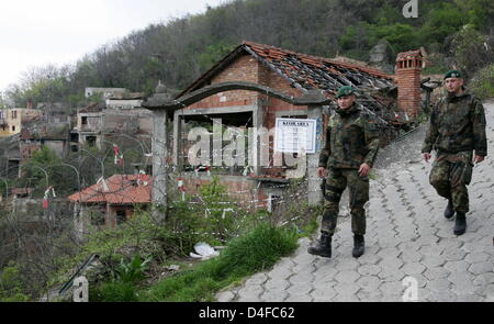 Two soldiers of German Bundeswehr patrol the destroyed and still closed Serbian quarter of Prizren, Kosovo, 06 April - Stock Photo