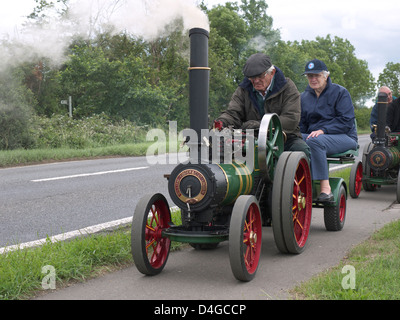 Miniature steam traction engines out on a road run at Morton steam and vintage weekend. - Stock Photo