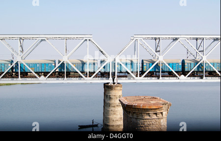 Goods Train Passing through the Steel Railway Bridge crossing the Krishna River at Vijayawada , Andhra Pradesh , - Stock Photo