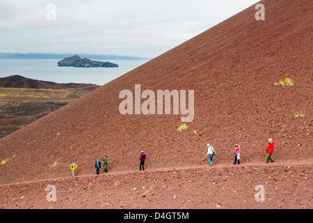 Hiking on recent lava flow on Heimaey Island, Iceland, Polar Regions - Stock Photo