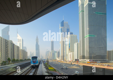 Metro and skyscrapers on Sheikh Zayed Road, Dubai, United Arab Emirates, Middle East - Stock Photo
