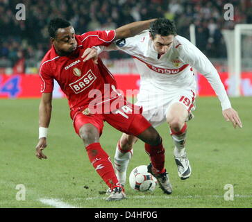 Stuttgart?s Roberto Hilbert (R) and Liege?s Landry Mulemo (L) seen in action during the UEFA Cup group C match VfB - Stock Photo