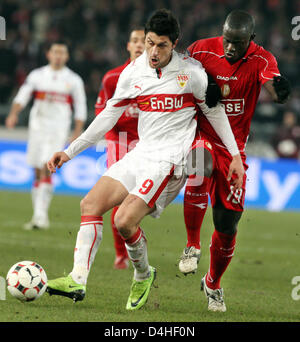 Stuttgart?s Ciprian Marica (L) and Liege?s Mohamed Saar (R) seen in action during the UEFA Cup group C match VfB - Stock Photo
