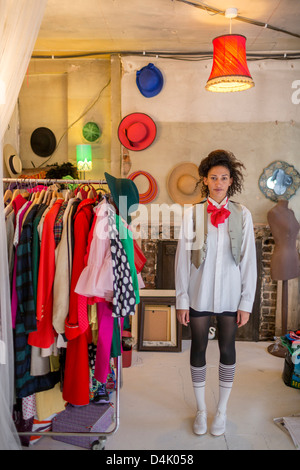 Woman standing in clothes shop - Stock Photo