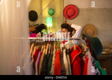 Woman shopping in clothes shop - Stock Photo