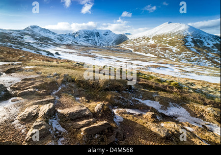Striding Edge, Helvellyn, Swirral Edge and Catstycam on a winters day. - Stock Photo
