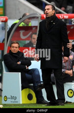 Stuttgart?s head coach Markus Babbel (R) gives instructions next to manager Horst Heldt during the German Bundesliga - Stock Photo