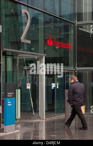 A man walking into the Santander UK Head Office at Regent's Place, London. - Stock Photo