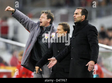 Stuttgart?s coach Markus Babbel (R), Manager Horst Heldt and Rainer Widmayer (L) gesture at the sideline during - Stock Photo