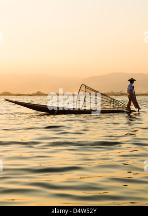 An Intha fisherman on Inle Lake, Burma - Stock Photo