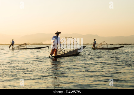 Traditional Intha fishermen on Inle Lake, Burma - Stock Photo
