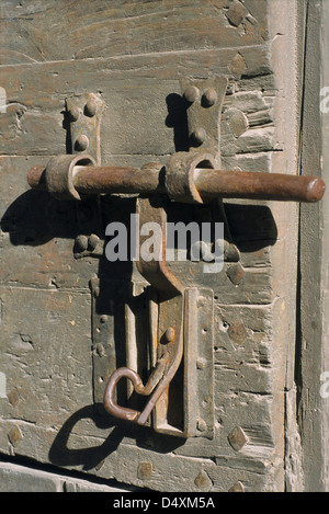 Old lock on old gate's town Porte d'Espagne, Villefranche de Conflent, Eastern Pyrenees, Languedoc-Roussillon, France - Stock Photo