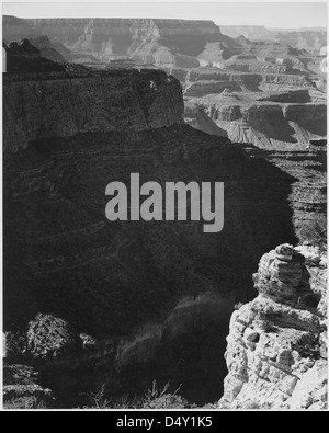 View of darkly shadowed canyon at left and center, from the 'South Rim, 1941, Grand Canyon National Park,' Arizona. - Stock Photo