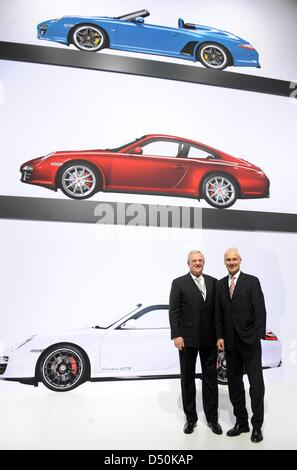 Martin Winterkorn (L), chairman of the board of directors of Porsche Automobil Holding SE stands together with Porsche - Stock Photo