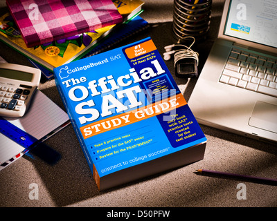 Still life of students desktop showing SAT study guide, laptop and books. - Stock Photo