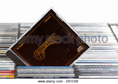 Carpenters album The Singles 1969-1973, piled music CD cases, England. - Stock Photo