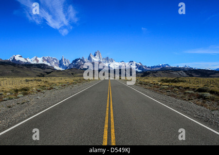 A long road leading to a beautiful Patagonian mountain range. - Stock Photo