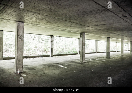 Pillars in empty parking structure - Stock Photo