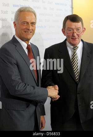 German Transport Minister Peter Ramsauer (L) and the designated chairman of the supervisory board of state-owned - Stock Photo