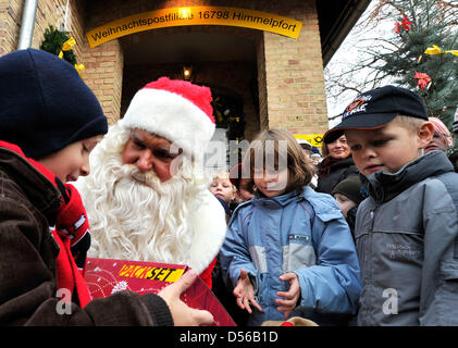 Santa Claus distributes presents to children during the opening of Christmas post office Himmelpfort, Germany, 11 - Stock Photo