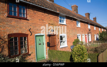 Row of small red brick traditional rural cottages, Long Row, Sudbourne, Suffolk, England - Stock Photo