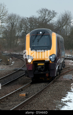 Arriva Cross Country Voyager train, head on in winter. - Stock Photo