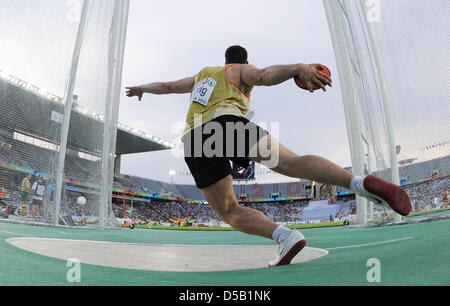 German discus thrower Martin Wierig throws at the European Athletics Championships in Barcelona, Spain, 01 August - Stock Photo