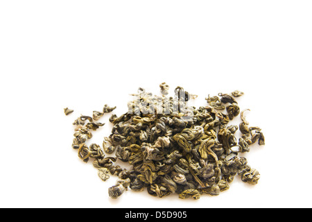 Heap of green tea close up isolated on white background. - Stock Photo
