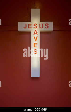 A Jesus Saves neon sign in the entrance of an evangelical church in Peckham, south London. Nearby are the voices - Stock Photo