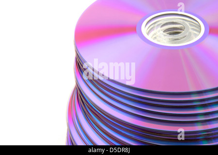 Stacked colorful DVDs or CDs isolated on white background. No dust. - Stock Photo
