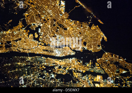 Aerial view of the greater New York City metropolitan area at night as seen from the Earth-orbiting International - Stock Photo