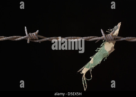 one rusty barbed wire on black background - Stock Photo