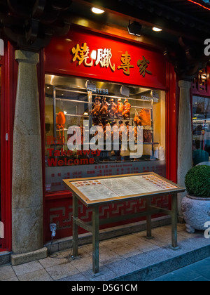 Entrance and menu Board of Chinese Restaurant in Chinatown, London - Stock Photo